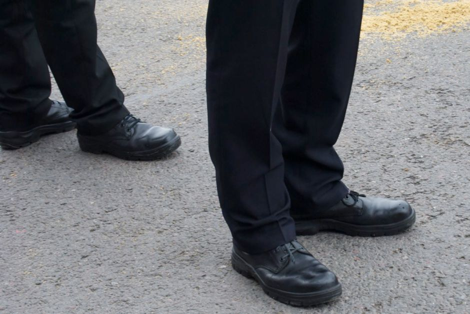 Some very large, very shiny shoes belonging to a typical British Bobby.
